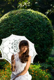 Pretty woman with sun umbrella Royalty Free Stock Photo