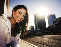 Pretty woman at sundown in city Royalty Free Stock Photo