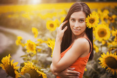 Pretty woman in a sunflower's field Royalty Free Stock Photography