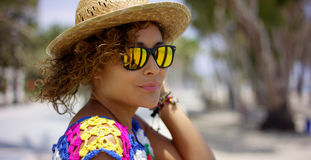 Pretty woman in sunglasses and hat outside Royalty Free Stock Photography