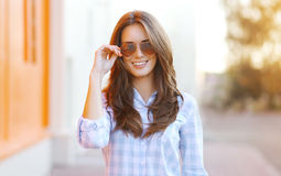 Pretty woman in sunglasses having fun Stock Image