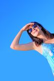 A pretty woman in sunglasses looking up Royalty Free Stock Images