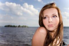 Pretty woman in sunlight Stock Photos