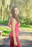 Pretty woman on sunny summer day walking in the park. Royalty Free Stock Photos