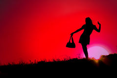 Pretty woman and sunset red. Pretty woman and sunset, red sky stock image