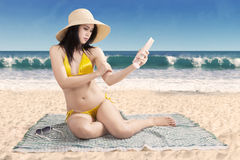 Pretty woman with suntan lotion Royalty Free Stock Photo