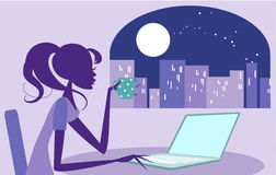 Girl working late on her laptop Stock Images