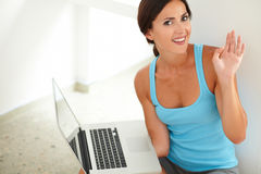 Pretty woman surfing the web on laptop Royalty Free Stock Photos