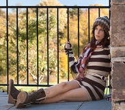Pretty Woman in Sweater Dress and Boots Royalty Free Stock Photography