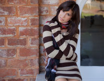 Pretty Woman in Sweater Dress Stock Photo