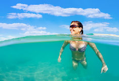 Pretty woman swim in red sea Royalty Free Stock Image