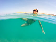 Pretty woman swim in red sea Royalty Free Stock Photography