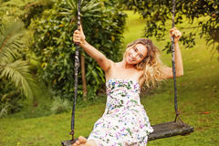 Pretty woman on a swing Royalty Free Stock Photos