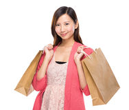 Pretty woman take shopping bag Stock Image