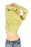 Pretty woman takes off a green sweater Stock Image