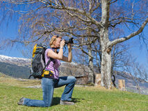 Pretty woman takes outdoor pictures Stock Image