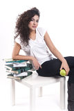 Pretty woman takes some rest. Young woman with green apple and books Stock Images