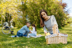 Pretty woman taking bananas out of basket Stock Photos