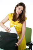 Pretty woman taking a laptop out Stock Image