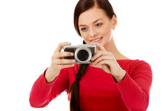 Pretty woman taking a photo using classic slr camera Royalty Free Stock Images