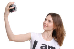 Pretty woman taking photo with vintage camera Stock Photo