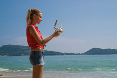 Pretty woman taking photos with drone camera Royalty Free Stock Images