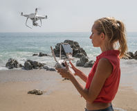 Pretty woman taking photos with drone camera Stock Photos