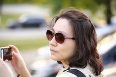 Pretty woman taking picture Stock Photo