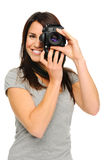 Pretty woman taking pictures Stock Images