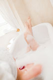 Pretty woman taking a relaxing bath Royalty Free Stock Photos