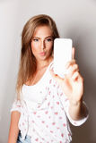Pretty woman taking a selfie Royalty Free Stock Photography