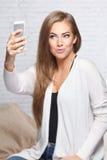 Pretty woman taking a selfie Royalty Free Stock Photos