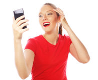 Pretty woman taking selfies. People, lifestyle and tehnology concept: pretty woman taking selfies with her smart phone - isolated on white Royalty Free Stock Photos