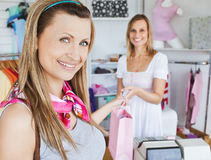 Pretty woman taking a shopping bag and smiling Stock Photography