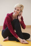 Pretty woman talking on her cell phone Stock Image