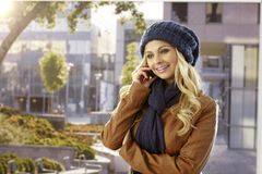Pretty woman talking on mobile outdoors Royalty Free Stock Photography