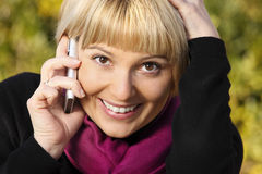 Pretty woman talking on the phone stock image