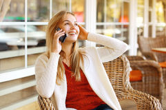 Pretty woman talking on the smartphone Stock Images
