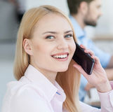 Pretty woman is talking on telephone Royalty Free Stock Photo