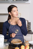 Pretty Woman Tasting Food on Hand Mixer Royalty Free Stock Images