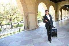 Pretty Woman Teacher Walking to Class Royalty Free Stock Photos