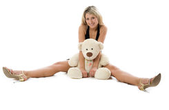 Pretty woman with teddy bear Stock Photography