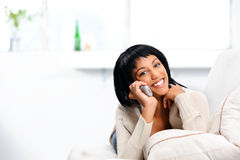 Pretty woman with telephone Stock Image