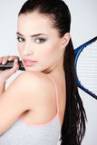 Pretty woman with tennis racket Royalty Free Stock Photos