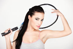Pretty woman with tennis racket Royalty Free Stock Images