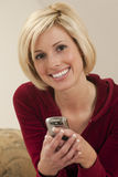 Pretty woman texting Stock Photo