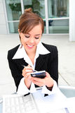 Pretty Woman Texting at Work royalty free stock photography