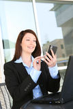 Pretty Woman Texting at Work Royalty Free Stock Images