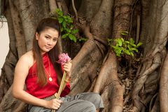 Pretty woman in Thai style clothes in posing  . Stock Image
