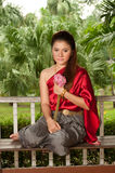 Pretty woman in Thai style clothes in posing . Stock Images